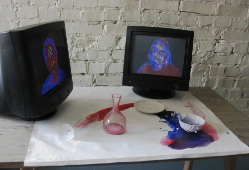 Picnic, 2012. Installation; dishes on table, paint, two computer screen with animation, moving heads (consist of time related words)