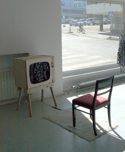 My Favorite Black and White Movie, 2013. Interactive installation; wood, acrylic on fishing line, chair, music. Music and movement in the screen starts when visitor sits on the chair. Programming: Antti Koskinen. Music and wood work: Jaakko Niemi.